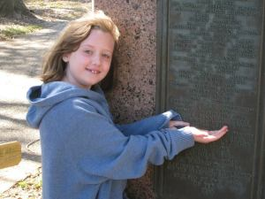 My daughter, pointing out our ancestor's name on the list of signers of the Texas Declaration of Independence.