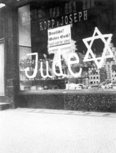 """Jude"", or ""Jew"" and a Star of David were painted on Jewish businesses and homes beginning in 1933 in the Nazi persecution of the Jewish people."